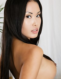 Sexy Davon Kim strips for us on the bed.