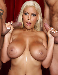 Incredibly Busty Bridgette Smothers Two Cocks