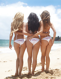 Check out this bikini threesome on the beach!