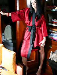 Her red satin robe is sexy an...