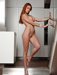 The redhead has a big ass and you get to see it in her erotic solo set
