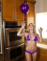 The super hot blonde wears a super hot bikini and toys her pussy deep