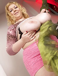 Massive Titted Blond Shows Curves