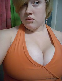 Photo gallery of an amateur BBW slut with gigantic tits