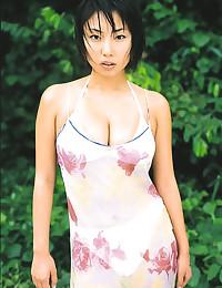 Busty asian Megumi posing her natural big breasts