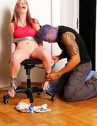 Bound girl sucks black dick