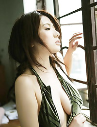 This naughty Asian babe loves showing off her body for the camera.