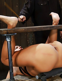 Bent and tied slut is toyed