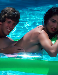 Young couple fools around in pool
