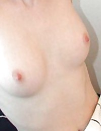 Picture gallery of an amateur petite babe showing her boobies