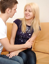 A horny blonde banged hard by her boyfriend on the couch