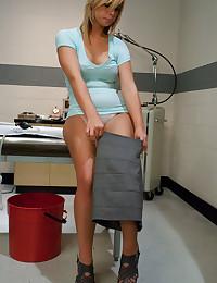 Nurse gives a girl an enema