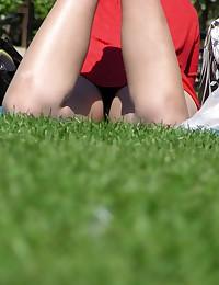 Sitting dark blonde in red. Up skirt amateur