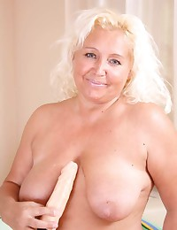 Mature blonde with sexy toy