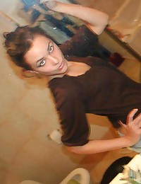 Hot big-tittied brunette chick self-shooting in front of a mirror