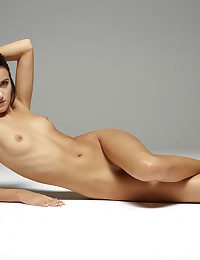 Gloria poses naked on the floor for us.