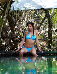 Bikini girl relaxes in pool