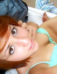 Teen redhead bikini self shot...