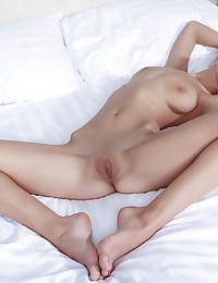 The blonde is incredibly beautiful and happily posing nude for you.