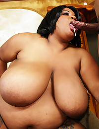 Fat ebony cocksucker blows him