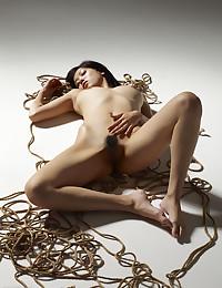 Konata lies on the floor completely naked!