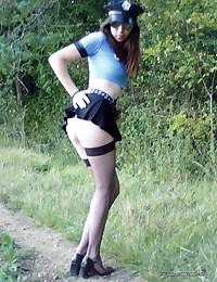 Photo collection of a hottie in a kinky police costume