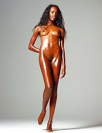 Naked black girl is oiled