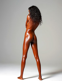 Naked black girl is oiled