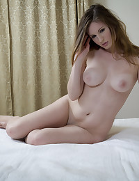 Giullietta poses naked in bed for our delight.