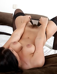 Kandie Luv looks gorgeous in her black corset and lingerie. She spreads her stocking clad legs wide and reveals her tender hairy pussy.