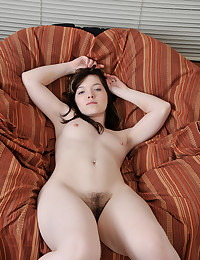 Nicole is resting comfortably on the couch and will strip for us.