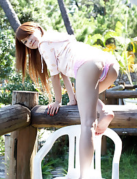 Fair Skinned Beauty Strips Outdoors