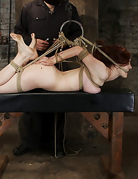 19yr old redhead with massive DD natural breasts is hogtied, anal hooked, finger fucked and made to cum over and over, is left suspended and hanging.