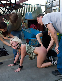 Hot blond gets fisted and ass fucked in front of strangers