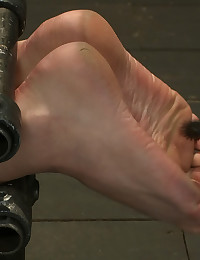 Lily is bound vulnerable and fucked hard to take a fisting she will never forget. Ass and pussy exposed for the taking. Feet torture to boot.