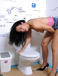Brunette loves cock trough holes in a toilet