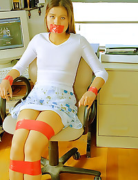 Slim teen taped to a chair