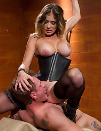 Hot black leather clad femdom dominatrix has dominating sex with muscular slaveboy.