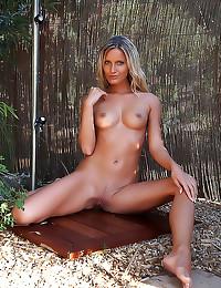 Slender tanned blonde outdoor...