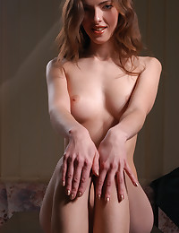 Watch Mara take off her white skirt.