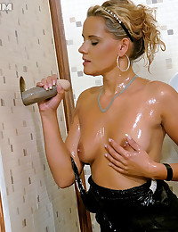 Fair haired beauty rubbing one out while slimed
