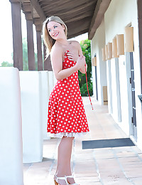 Cute girl in polka dot dress