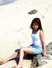Upskirts on beach with Japane...