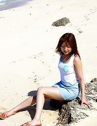 Upskirts on beach with Japane...