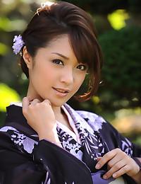 Pretty Japanese Babe Strips Naked