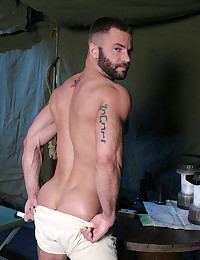 Hairy military man poses