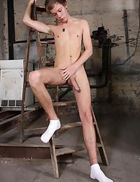 Slender boy masturbates fat cock