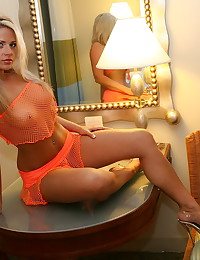 Ann Angel - Sexy blonde in erotic sensual orange fishnet lingerie