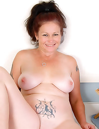 Yummy tattoed mature hot stri...