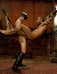 Alessio and Leo are in incredible bondage suspension during the live shoot.